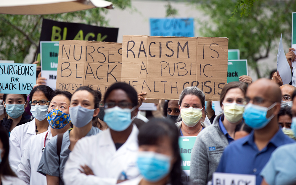 An image of UCLA Health clinical staff at a protest. At UCLA, we're not here to simply heal the organism.